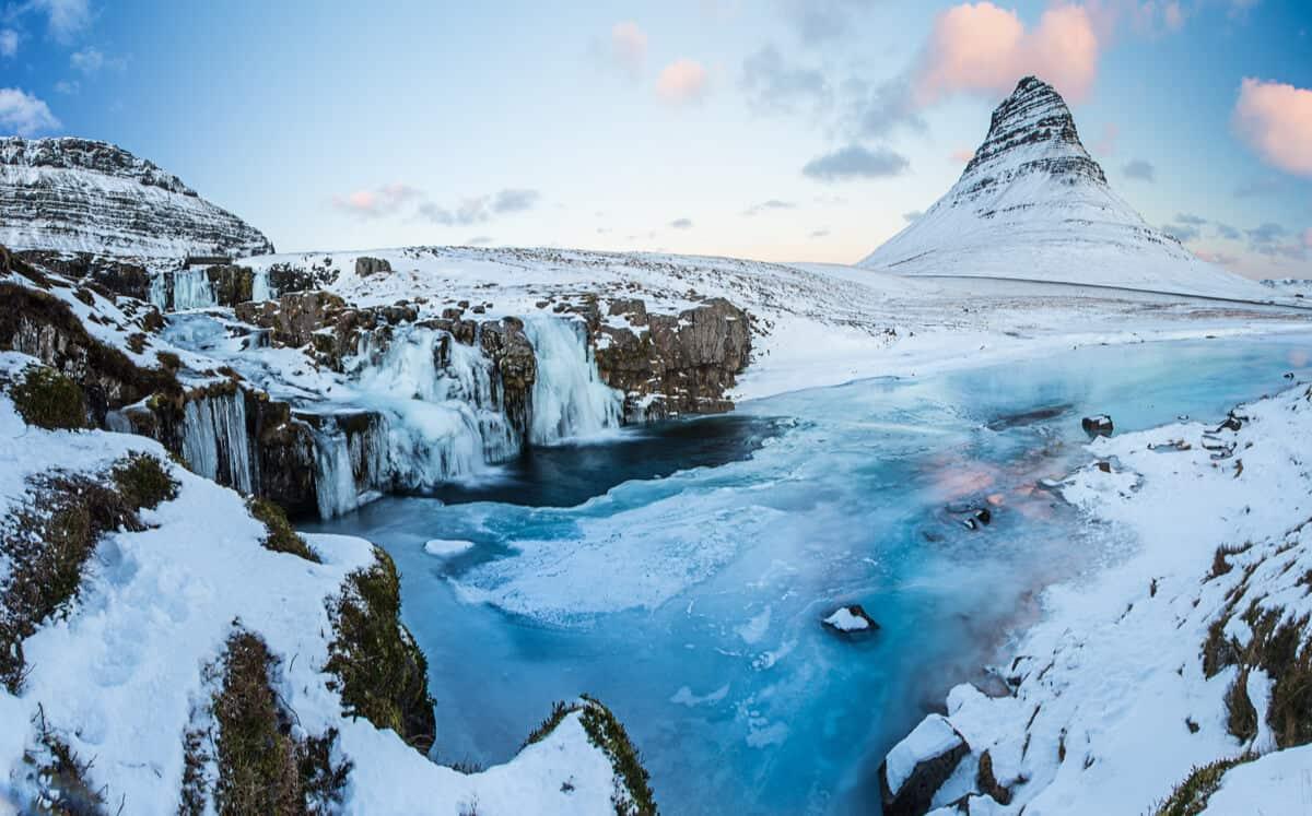 Snow covered landscapes at Kirkjufell mountain and Kirkjufellsfoss waterfall in Snaefellsnes peninsula