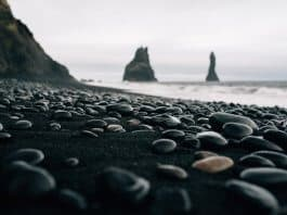 View of pebbles on Iceland's black sand beach Reynisfjara