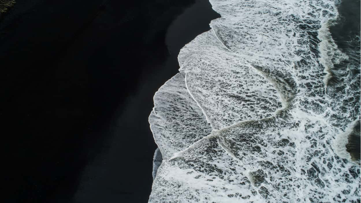 Black sand beaches in Iceland have sneaker waves
