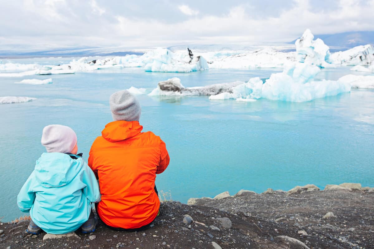 Iceland family vacation with father and daughter enjoying the glacier lagoon