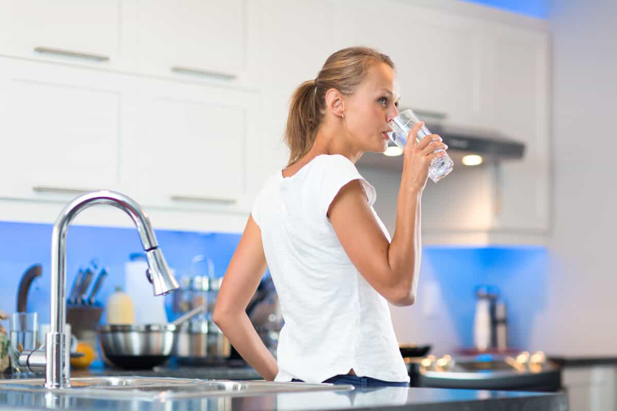 Woman drinking Iceland tap water